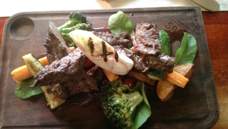 Лосятина под винным соусом с гарниром из жареных овощей. Local moose with butter fried vegetables and wine sauce.
